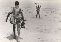 An EPLA fighter disarms an Ethiopian soldier