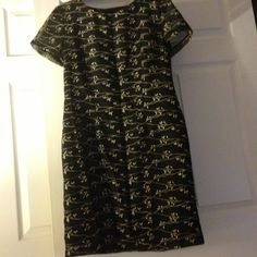 Gorgeous dress with soft gold embroidery Gorgeous dress with soft gold embroidery.  Size 12.  Body of the dress is lined. Used. Very well cared for. KC Spencer New York Dresses