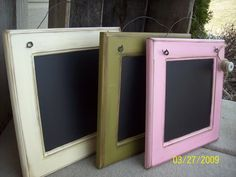 repurposed cabinet doors -- clip photos or artwork to the twine between the wires