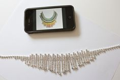 Create your own designer necklace from fashion jewelery and nail polish.