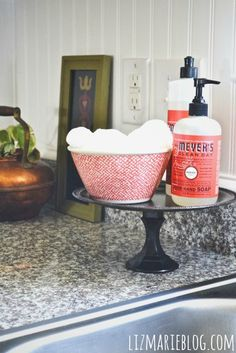 How perfect is this!? Cake stand for kitchen sink essentials.  Excuse to buy pretty soap :)