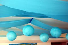 Deco Tip: plastic table clothes made to look like waves on the ceiling.