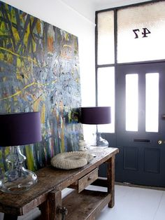 not usually a big fan of purple, but love this entryway!    (minus coil-thing on the table)