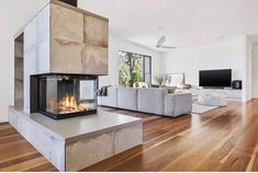 The centre of attention, the Radiante 846 3V offers a contemporary hearth design, where one fire warms and delights two spaces. Image from Pivot Homes. Double Sided Fireplace, Open Fireplace, Custom Home Designs, Custom Built Homes, Hearth, Cast Iron, Ikea, Fire Places, House Design