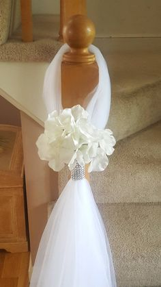d91d4db4b388 Tulle hangers wrapped with rhinestones with a silk flower attached. Each  one hangs 3ft long