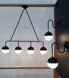 Balise pendant and wall lights by Gabriel Abraham of Atelier de Troupe.