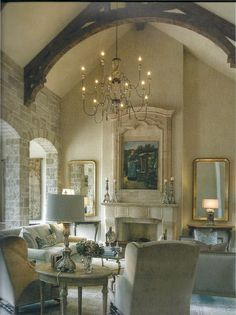 The soft limestone look with the soft blue, the vaulted ceiling and chandelier, twin gilt mirrors, carved surrounding of the art