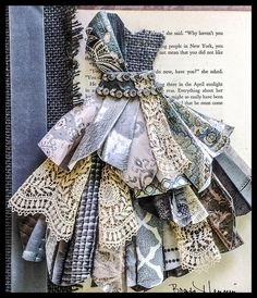 Original pinners excellent first paper dress...added antique lace, old book page, vintage necklace trim, vintage ribbon and gray burlap...in a shadowbox frame....my favorite: