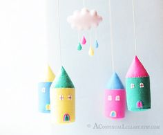 Cloud Rain House Mobile, Rainy Day, Pink Yellow Blue, Cloud Mobile, Rain Mobile, Cloud and Rain, Cloud Nursery Decor, Baby Girl Nursery by AContinualLullaby on Etsy https://www.etsy.com/listing/102924414/cloud-rain-house-mobile-rainy-day-pink