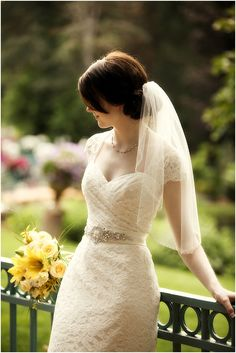 Lace wedding dress with belt image by Logan Walker Photography, see more http://www.frenchweddingstyle.com/wedding-at-la-caille/