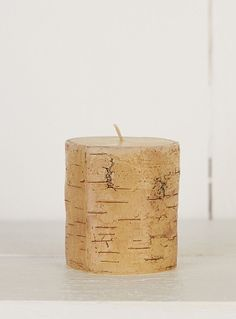 Ivory candle that recreates the knotted, textured look of wood bark for a fashionable chic, rustic style. Pillar style candle available in 3 different sizes. Table Accessories, Kitchen Accessories, Accessories Online, Candle Lanterns, Pillar Candles, Wood Bark, Interior Lighting, Dining Room Table, Table Centerpieces