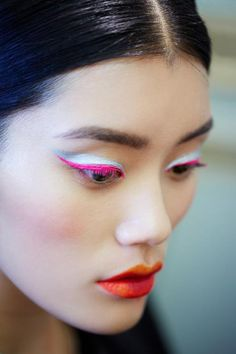 Dior Haute Couture A/W 2012. eyeliner, pink makeup. dramatic. fashion catwalk runway