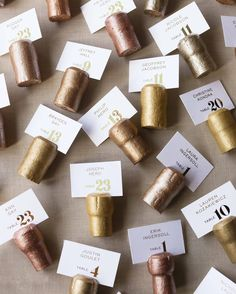To hold the escort cards in New Year's Eve style, Champagne corks (ordered online in bulk) were hand-painted and scored by Carrie, McCormick, and other friends and family members—one of several projects that occupied the weeks leading up to the wedding.