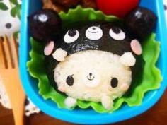 White bear wearing black bear onigiri