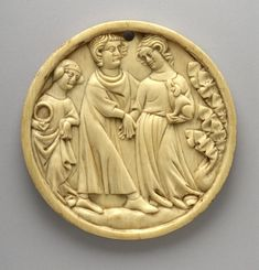 14th cent France. Mirror-case; ivory; carved; circular; depicts man and woman holding hands; woman holds dog; figure carrying wreath on left; tree on right; hole pierced in top.