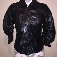 Sexy leather jacket Hits right at waist. So stylish and unique. Ruffel in front hides zipper. Fitted. Scrunched 3/4 sleeves. Amazing! Jackets & Coats