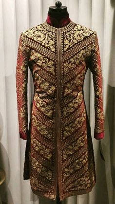 Fully golden and red zardosi handwork sherwani.Get the outfit for Manufacturer rate call or WhatsApp at Mens Wedding Wear Indian, Mens Indian Wear, Indian Men Fashion, Wedding Men, Wedding Suits, Indian Groom Dress, Achkan, Wedding Sherwani, Vogue India
