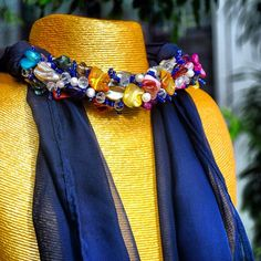 Scarf embellished with handmade beadwork art. Use our designs to get inspired for the fall fashion season.