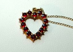 Hey, I found this really awesome Etsy listing at http://www.etsy.com/listing/151162427/vintage-bohemian-garnet-heart-pendant