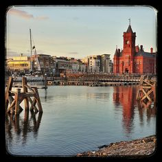 Reflection at Sunset - Pier head Building in Cardiff by BeyondtheWhiskers, via Flickr