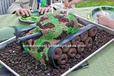 Army Tank Cake: My son asked for an army party with an army tank cake. I got some great ideas from this website, then added some of my own touches.  To get the tank shape,