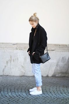 Shop this look on Lookastic:  http://lookastic.com/women/looks/low-top-sneakers-boyfriend-jeans-crossbody-bag-coat-crew-neck-t-shirt/6757  — White Low Top Sneakers  — Light Blue Ripped Boyfriend Jeans  — Black Leather Crossbody Bag  — Black Coat  — Black Crew-neck T-shirt