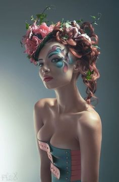Fascinating makeup matched to hair and decorative headpiece. Strange corset matching color scheme.