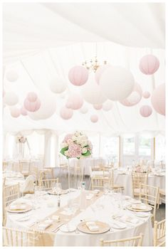 Super chic Pink & White Paper Lanterns in the Marquee at Middleton Lodge...we also created Tall centrepieces of Hydrangeas & Roses and added sequin runners & gold Plate Chargers www.weddingandevents.co.uk North Yorkshire Wedding Flowers