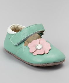 Adorned with a flower, these mary janes appeal to petite feet. A soft leather upper and a hook and loop closure keep toes in tow, while a cushy collar and rubber pads on the outsole ensure little ones are always comfortable.