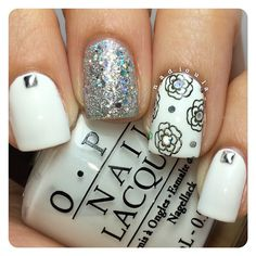 OPI Alpine Snow stamped using CICI&SISI 05. Glitter is OPI It's Frosty Outside and OPI Snowflakes In The Air. Studs from Born Pretty store.
