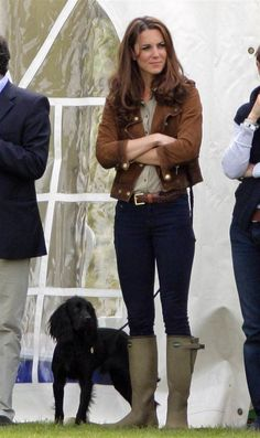 Casually cool    Duchess Kate dresses down in jeans and $500 wellies to watch her husband, Prince William play in a polo match on June 17.