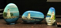 painting of lighthouses on rocks