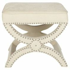 """Bring a pop of chic style to your living room or den with this Savonarola-style ottoman, showcasing nailhead trim and curved legs.   Product: OttomanConstruction Material: Pinewood, plywood and linenColor: CreamFeatures: Nailhead trimDimensions: 19"""" H x 21.5"""" W x 21.5"""" DCleaning and Care: Professional cleaning recommended"""
