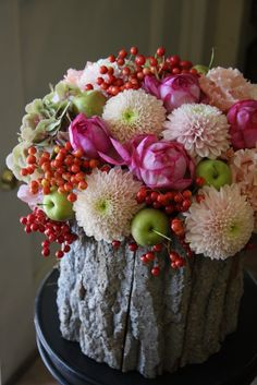I love this amazing flower arrangement with roses, mums, pepper berries, and green apple~