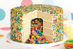 Three, two, one... surprise! Bring on the wow factor with this show-stopping rainbow pinata cake.