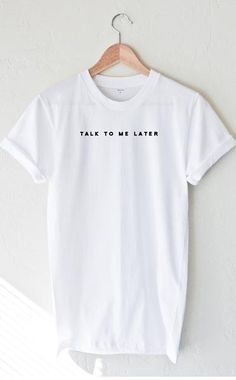 "- Description Details: Soft, unisex fit t-shirt in white with print featuring 'Talk To Me Later'. Brand: NYCT Clothing. Unisex, loose fit. Measurements: (Size Guide) S: 36"" bust, 27"" length M: 40"" bus"