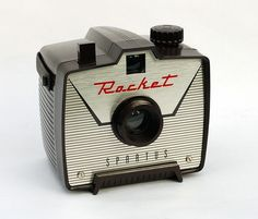 Spartus Rocket    Made c1962 by the Spartus Corporation of Chicago, the Rocket is a small plastic box camera with a great space-age design. Basically the same as the Spartus Vanguard, but with a much cooler faceplate! :o)
