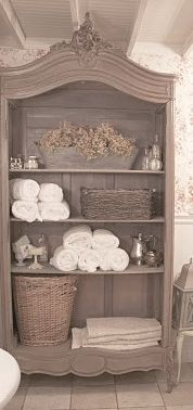 Try a wood shelf as a bathroom towel closet.   Find one here...