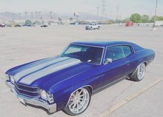 71 chevelle blue with silver stripes and concave multi spoke wheels