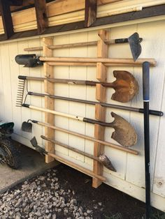 This is a guide to making a cheap and simple garden tool rack. This one is for m. This is a guide to making a cheap and simple garden tool rack. This one is for my dad's shed and keeps all the tools safely of the floor. Garage Tool Storage, Garage Shed, Garage Tools, Shed Storage, Craft Storage, Outdoor Tool Storage, Storage Hooks, Firewood Storage, Yard Tool Storage Ideas