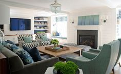 Love the window seats flanking the fireplace.  Solid color seat with colorful window treatment