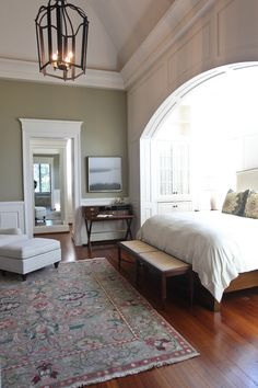 Charleston bedroom by Margaret Donaldson Interiors. Gorgeous, but I would have to install blackout curtains over the skylights!