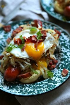 Breakfast Hot Dog - Topped with crispy hashbrowns, a sunny side up egg, cilantro and BACON