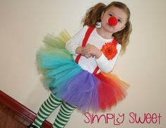 easy clown costume: striped tights, colorful tutu and a nose! LOVE.