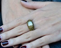 Estate 3.0 CTW Yellow Sapphire and Diamond Ring. 18 karat white gold ring with nine princess cut diamonds at 0.45 CTW SI clarity and G-H color surrounded by round yellow sapphires, size 6.75. Appraised at $5600.