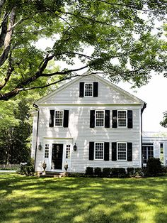 Branches of a maple tree frame this Connecticut farmhouse's facade. A Frame Cabin, White Cottage, Step Inside, White Houses, Architecture Details, Home Design, House Colors, Curb Appeal, My Dream Home