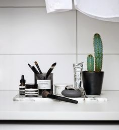 8 Ways To Turn Clutter Into Stylish Decor: Reuse Empty Candle Jars You can find amazing candles with lovely scents and packaging almost anywhere you shop. If you're like me, you have a few (almost) empty jars hanging around. Don't throw them away, instead use the containers to store anything from makeup brushes to plants.