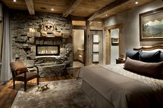 If this doesn't say cozy bedroom, I don't know what does!   #rustic #bedroomfireplace #archilovers