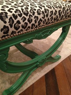 Currey and Company. Leopard fabric with nail head trim on green painted stool