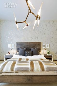 Setting the Stage: Dufner Heighes Designs Dynamic Model Apartment For Luxury NoHo Building | The master bedroom features an Adelman chandelier and wallpaper by artist Kiki Smith. #design #interiordesign #interiordesignmagazine #architecture #bedroom #furniture #lighting